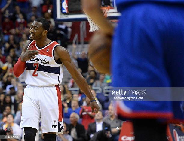 Washington Wizards point guard John Wall celebrates after sinking an early three pointer during the home opener between the Washington Wizards and...