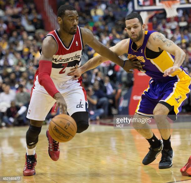 Washington Wizards point guard John Wall drives against Los Angeles Lakers point guard Jordan Farmar during the second half of their game played at...