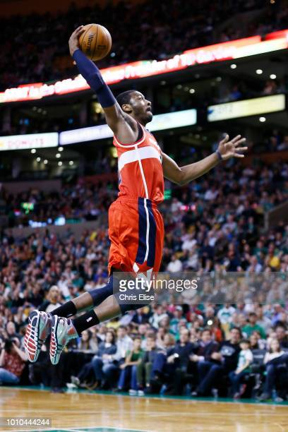 Washington Wizards point guard John Wall goes for the dunk on a fast break during the Boston Celtics 10796 victory over the Washington Wizards at TD...