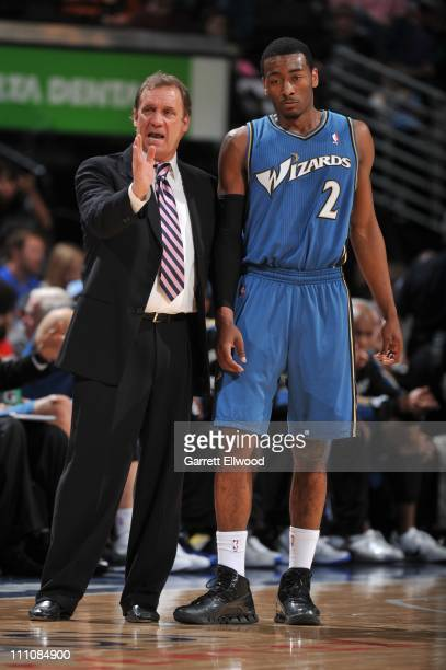 Washington Wizards point guard John Wall listens to Washington Wizards head coach Flip Saunders during the game against the Denver Nuggets on March...