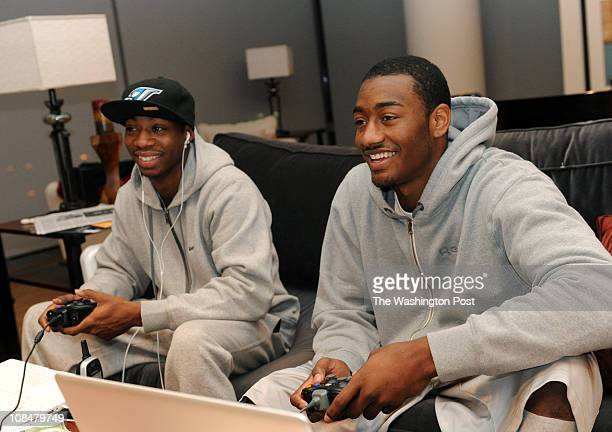 Washington Wizards point guard John Wall right plays video games with his best friend Ty Williams at his Washington DC apartment on Monday December...