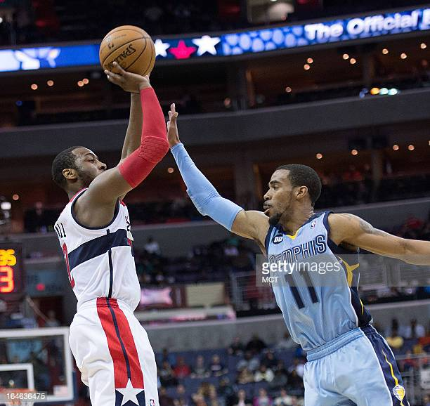 Washington Wizards point guard John Wall shoots over Memphis Grizzlies point guard Mike Conley during the second half of their game played at the...