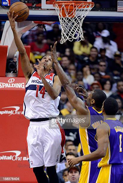 Washington Wizards point guard Shaun Livingston puts up a shot against Los Angeles Lakers small forward Metta World Peace and Lakers point guard...