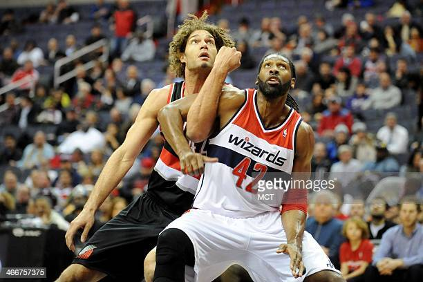 Washington Wizards power forward Nene Hilario and Portland Trail Blazers center Robin Lopez fight for position during the first half at the Verizon...