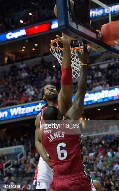 Washington Wizards power forward Nene Hilario blocks the shot of Miami Heat small forward LeBron James during the first half of their game played at...