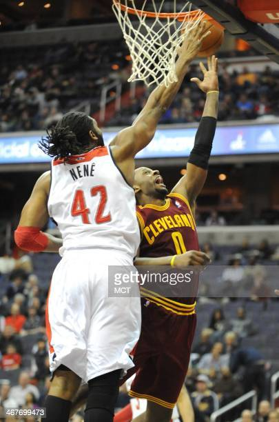 Washington Wizards power forward Nene Hilario blocks the shot of Cleveland Cavaliers shooting guard CJ Miles during the first half against the...