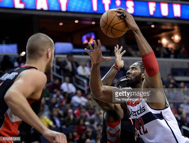 Washington Wizards power forward Nene Hilario drives toward the basket for two during the first half of the game between the Washington Wizards and...