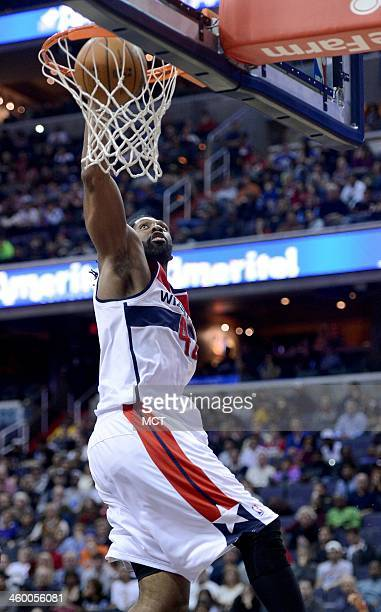 Washington Wizards power forward Nene Hilario dunks against the Dallas Mavericks in the fourth quarter at the Verizon Center in Washington DC Wed Jan...