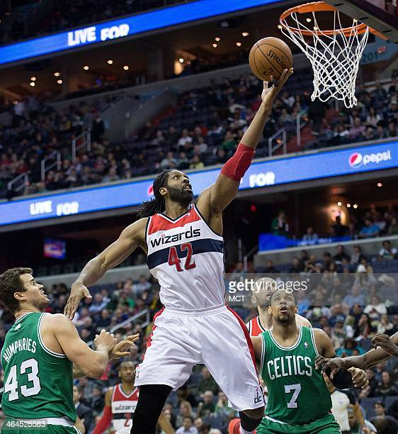 Washington Wizards power forward Nene Hilario scores against Boston Celtics center Kris Humphries during the second half of their game played at the...