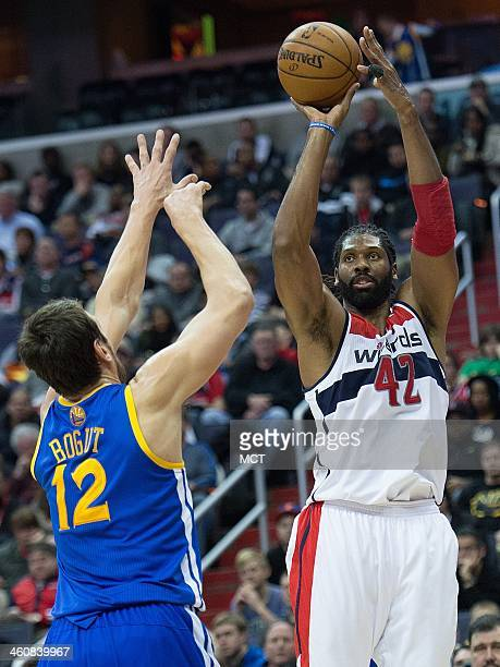Washington Wizards power forward Nene Hilario shoots over Golden State Warriors center Andrew Bogut during the second half of their game played at...