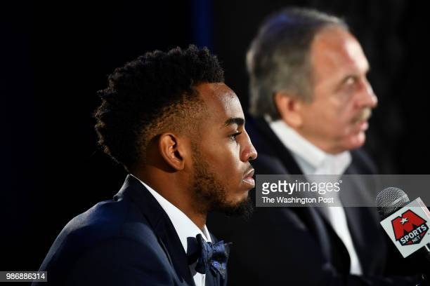 Washington Wizards President Ernie Grunfeld introduces right Troy Brown Jr the team's firstround pick in the 2018 NBA Draft at a press conference at...