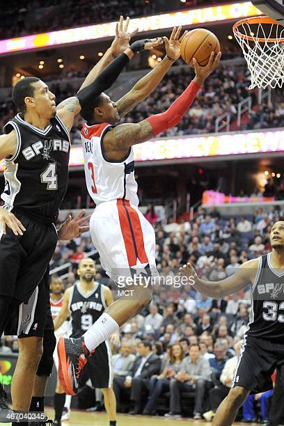 Washington Wizards shooting guard Bradley Beal goes to the basket over San Antonio Spurs shooting guard Danny Green during the first half at the...