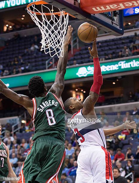 Washington Wizards shooting guard Bradley Beal shoots a reverse layup over Milwaukee Bucks center Larry Sanders during the second half of their game...