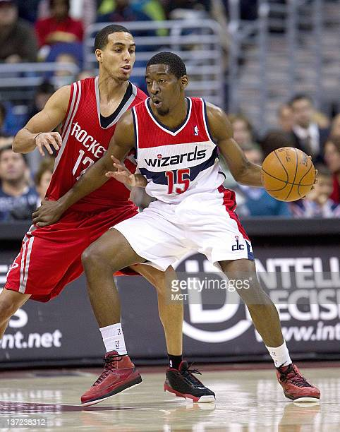 Washington Wizards shooting guard Jordan Crawford is defended by Houston Rockets shooting guard Kevin Martin during their game played at the Verizon...