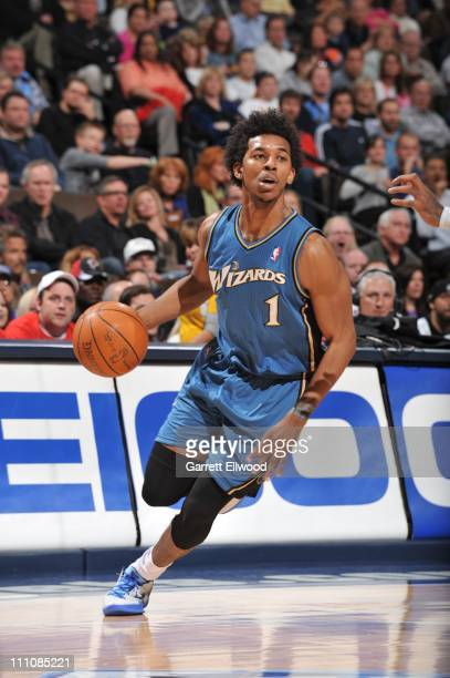 Washington Wizards shooting guard Nick Young brings the ball up court during the game against the Denver Nuggets on March 25 2011 at the Pepsi Center...