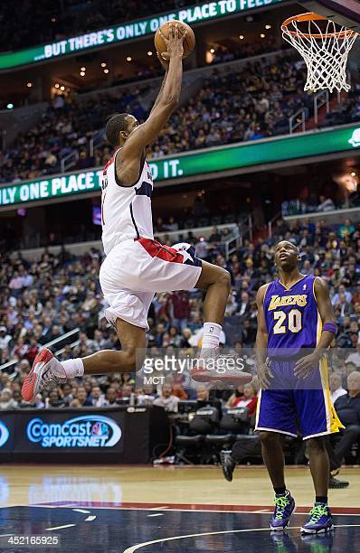 Washington Wizards small forward Trevor Ariza flies in for a slam dunk in front of Los Angeles Lakers shooting guard Jodie Meeks during the second...