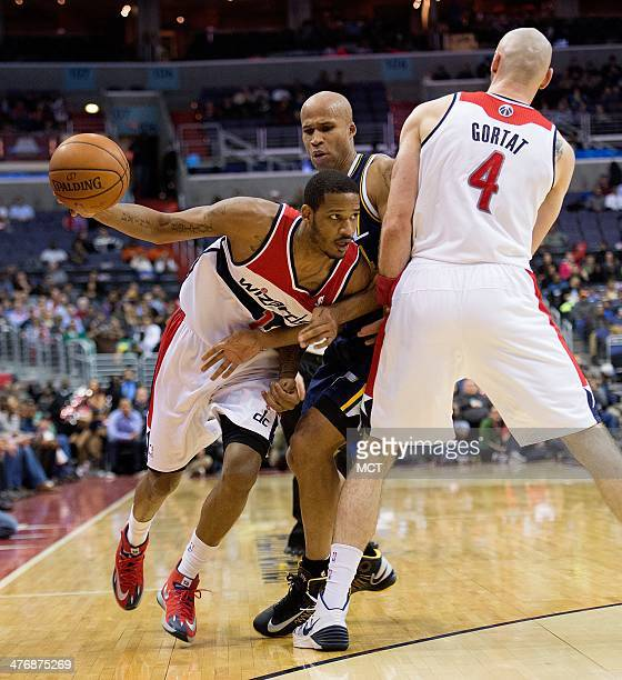 Washington Wizards small forward Trevor Ariza gets away from Utah Jazz small forward Richard Jefferson on a pick set by Wizards center Marcin Gortat...