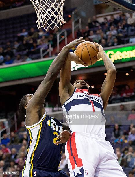 Washington Wizards small forward Trevor Ariza scores over Utah Jazz power forward Marvin Williams during the first half of their game played at the...