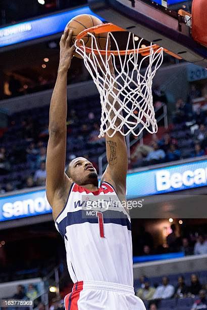 Washington Wizards small forward Trevor Ariza slam dunks against the New Orleans Hornets during the first half of their game played at the Verizon...