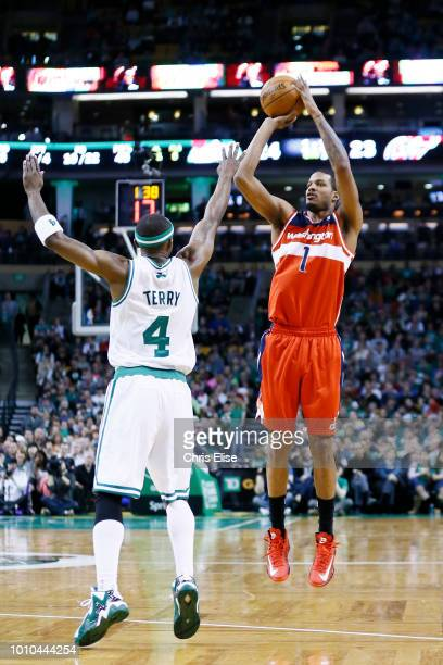 Washington Wizards small forward Trevor Ariza takes a jumpshot over Boston Celtics shooting guard Jason Terry during the Boston Celtics 10796 victory...