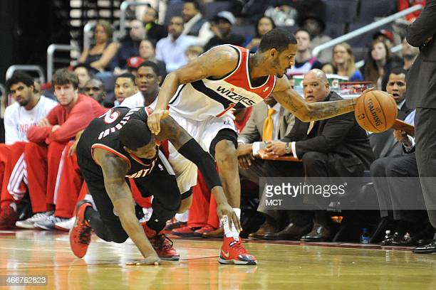 Washington Wizards small forward Trevor Ariza takes the ball from Portland Trail Blazers shooting guard Wesley Matthews during the first half at the...