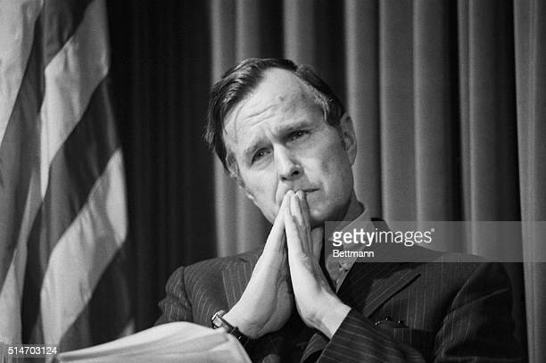 CIA Director George Bush strikes a pensive pose February 18 as he briefs reporters on the specifics of Pres Ford's proposals for reform of the US...