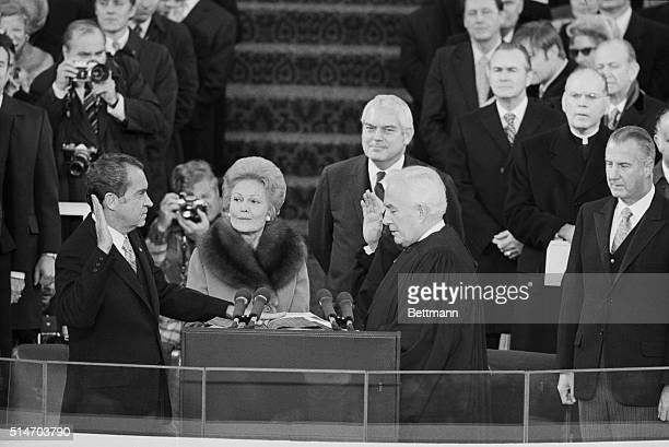 Washington:Pres.Nixon takes his oath of office for his second term in a ceremony in the Capitol Plaza. Administering the oath is Chief Justice of the...