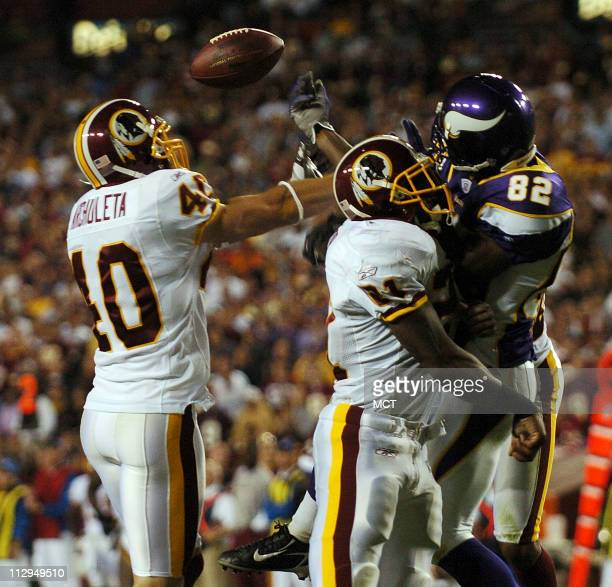 Washington's Adam Archuleta and Sean Taylor break up a pass intended for Minnesota wide receiver Troy Williamson during the third quarter of Monday...