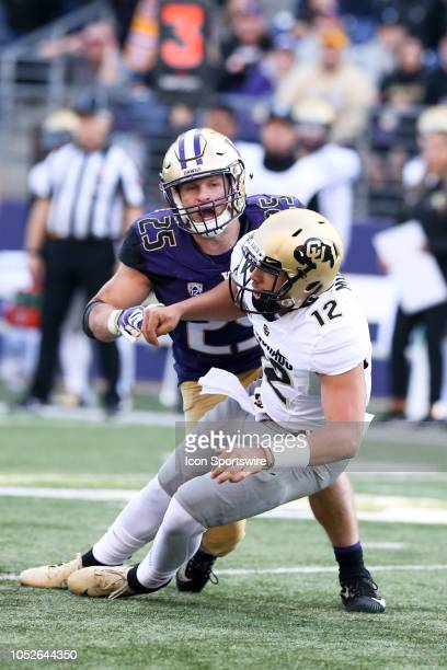 Washington's Ben BurrKirven knocks down Colorado's Steven Montez behind the line of scrimmage during the college football game between the Washington...