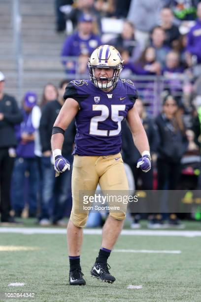 Washington's Ben BurrKirven lets out a scream after making a stop at the line of scrimmage during the college football game between the Washington...