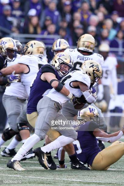 Washington's Ben BurrKirven wraps up Colorado's Travon McMillian at the line of scrimmage during the college football game between the Washington...