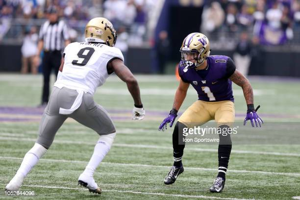 Washington's Byron Murphy sets up on defense against Colorado's Juwann Winfree during the college football game between the Washington Huskies and...