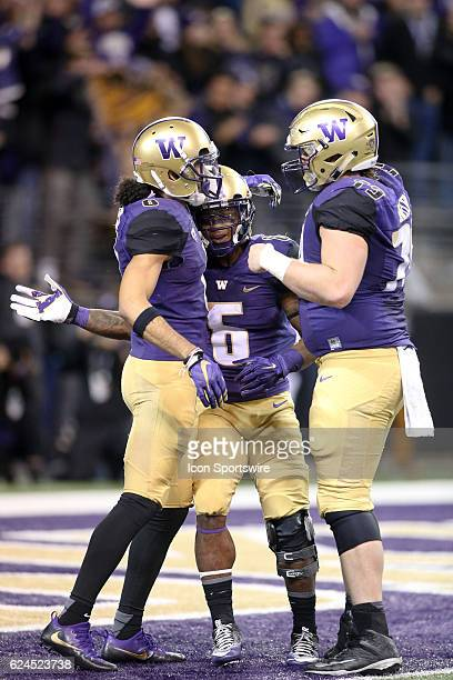 Washington's Dante Pettis celebrates with Chico McClatcher and Coleman Shelton after hauling in a Jake Browning pass for a second quarter touchdown...