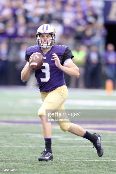 Washington's Jake Browning looks for an open receiver down field during a college football game between the Washington Huskies and the Montana...