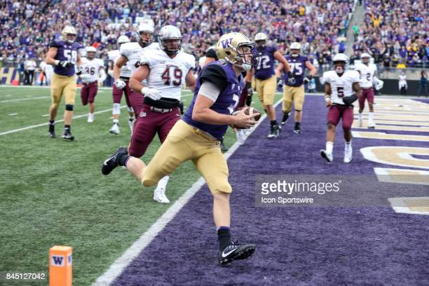 Washington's Jake Browning races into the end zone untouched for a first quarter touchdown in the game between the Washington Huskies and the Montana...