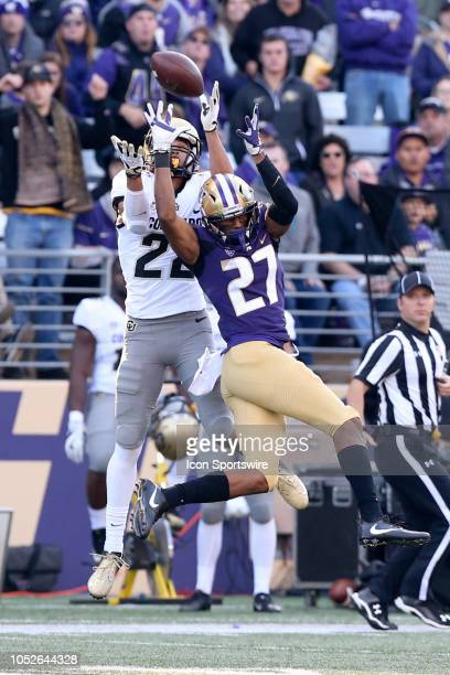 Washington's Keith Taylor knocks the ball away from Colorado's Daniel Arias in the end zone during the college football game between the Washington...