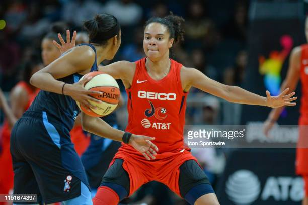 Washington's Kristi Toliver plays tight defense on Atlanta's Renee Montgomery during the WNBA game between the Atlanta Dream and the Washington...
