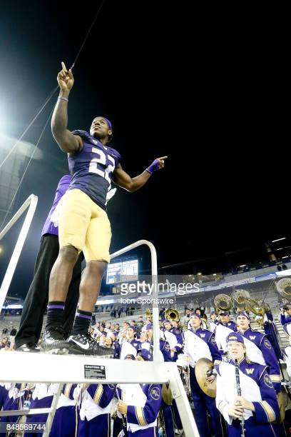 Washington's Lavon Coleman leads the band in the playing of the school fight song after the game against the Fresno State Bulldogs on September 16...