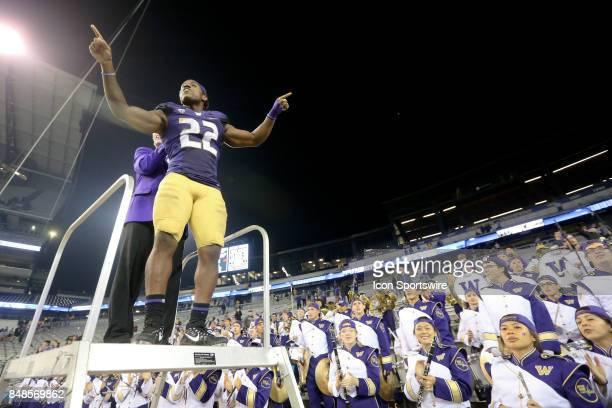 Washington's Lavon Coleman leads the band in the playing of the school fight song after the game against the Fresno State Bulldogs on September 16,...