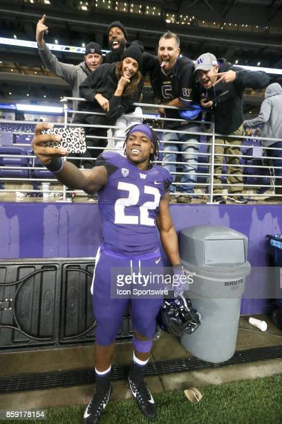 Washington's Lavon Coleman poses for a picture with fans after the game between the Washington Huskies and the California Bears on October 7 2017 at...