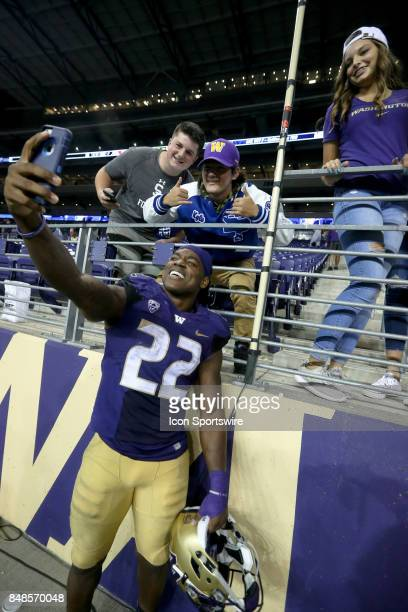 Washington's Lavon Coleman takes a selfie after the game against the Fresno State Bulldogs on September 16 2017 at Husky Stadium in Seattle WA