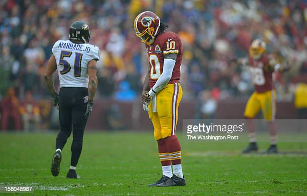 Washington's quarterback Robert Griffin III during a contemplative moment in the second quarter as the Washington Redskins play the Baltimore Ravens...