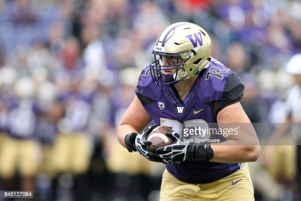 Washington's Trey Adams hauled in a Jake Browning pass and races towards the end zone against Montana during a college football game between the...