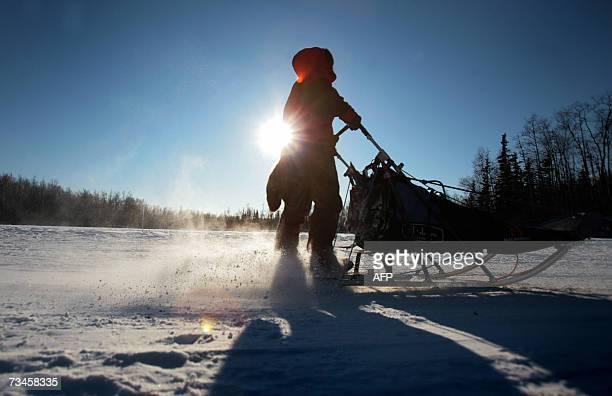 Iditarod rookie Norwegian Sigrid Ekran runs her team through a practice trail in Wasilla Alaska 28 February 2007 prior to the 2007 Iditarod sled dog...