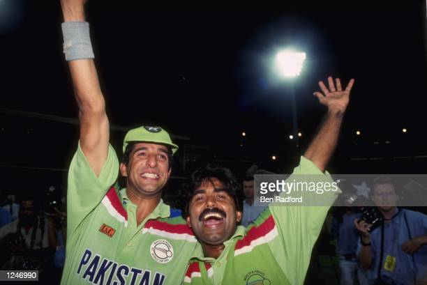 Wasim Akram and Javed Miandad celebrate after Pakistan beat England in the final of the Cricket World Cup at the MCG in Melbourne Australia