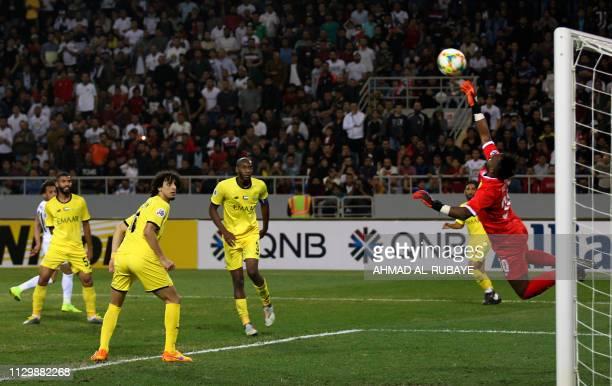 Wasl's goalkeeper Humaid AlNajar deflects the ball during the AFC champions league Group A football match between Iraq's Al Zawraa and UAE's Al Wasl...