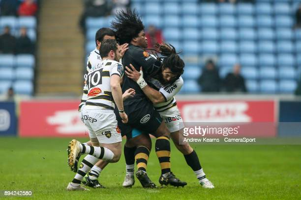 Wasps' Ashley Johnson is tackled by La Rochelle's Rene Ranger as La Rochelle's Ryan Lamb arrives during the European Rugby Champions Cup match...