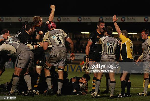 Wasps celebrate as they drive over Serge Betsen to score a try during the AVIVA Premiership match between London Wasps and Newcastle Falcons at Adams...