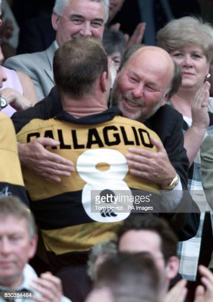 Wasp's celebrate their victory as Chairman Chris Wright hugs winning captain Lawrence Dallaglio after their Tetley's Bitter Cup final against...