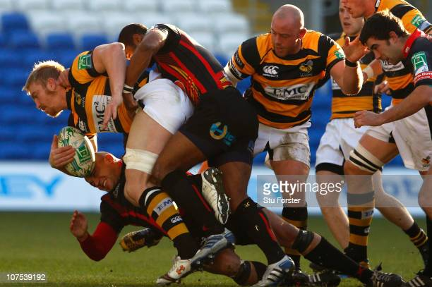 Wasps centre Andy Powell is tackled by the Dragons defence during the Heineken Cup Round Three match between Newport Gwent Dragons and London Wasps...